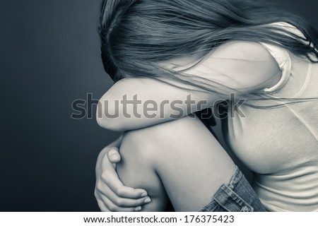 Dramatic Image Of A Sad Teenage Girl Crying