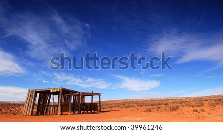 Dramatic image of an old abandoned building in the desert of Monument Valley