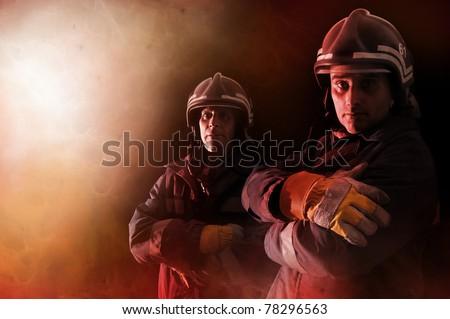 Dramatic image of firemen team in uniform