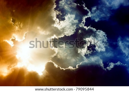 Dramatic impressive background -  sky with bright sun and dark clouds