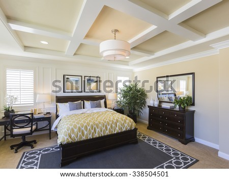 Dramatic Interior of A Beautiful Master Bedroom. The framed art is photographer\'s copyright.