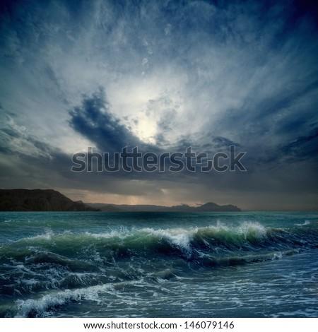 Dramatic landscape - dark stormy sky, sea waves, mountains #146079146
