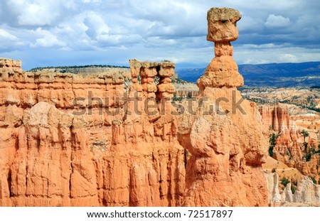 Dramatic landscape of Bryce Canyon National Park is populated with vibrant orange sandstone spires sculpted by the forces of nature.  Erosion caused by wind and rain carve interesting shapes.