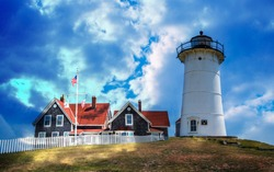 Dramatic light floods the Nobska lighthouse in Cape Cod