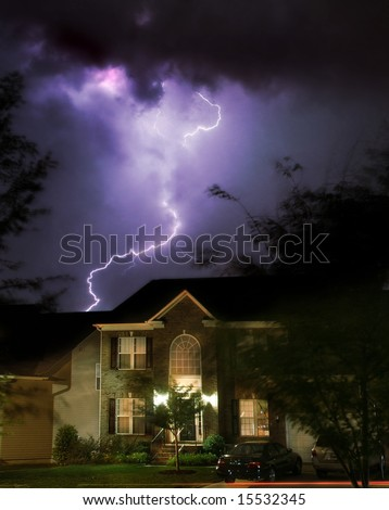 Dramatic lightening storm over suburban home