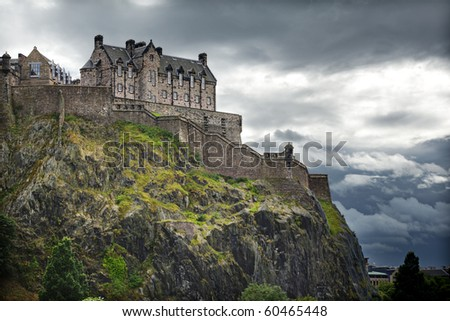 Dramatic lighting as storm clouds gather around Edinburgh Castle in Scotland