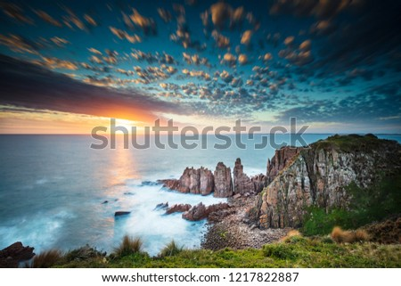 Dramatic long exposure image of the sunset overlooking the Pinnacles a famous rock formation on Phillip Island, Victoria Australia #1217822887