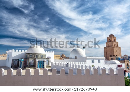 Dramatic looking sky with the Great Mosque in the background in Kairouan, Tunisia #1172670943
