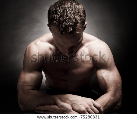 Dramatic male bodybuilder pose