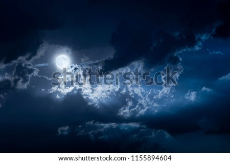 Dramatic Nighttime Clouds and Sky With Beautiful Full Blue Moon #1155894604