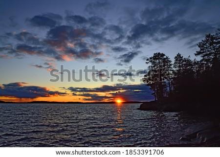 Dramatic northern sunset in purple tones. Lake Keret, North Karelia, Russia Stock fotó ©