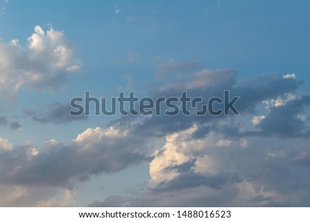 Dramatic picturesque colorful sky with cloud and picturesque scenic feather sunbeams before sunset #1488016523