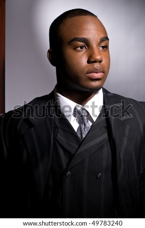 stock photo : Dramatic portrait of a dignified young black man in a dark suit