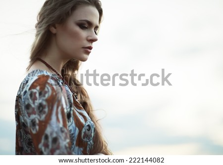 Dramatic portrait of beautiful hippie girl outdoors Boho fashion style