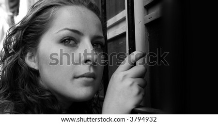 Dramatic portrait of the young woman - stock photo