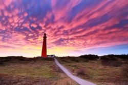 dramatic purple mammatus clouds over lighthouse, Schiermonnikoog