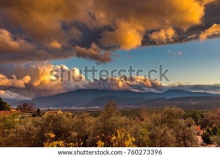 Dramatic rain clouds over the mountains #760273396