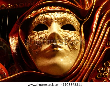 Dramatic red and gold Venetian mask #1108398311