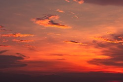 Dramatic red and orange sky and clouds abstract background. Red-orange clouds on sunset sky. Warm weather background. Art picture of sky at dusk. Sunset abstract background. Dusk and dawn concept