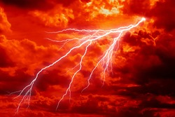 dramatic Red clouds and lightning for pattern background. A burning sky in a horror movie.  crimson storm in apocalyptic, judgment day.
