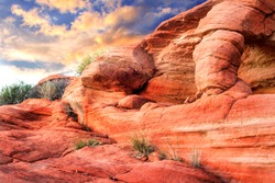 Dramatic Red rock sculpture with sunset in background