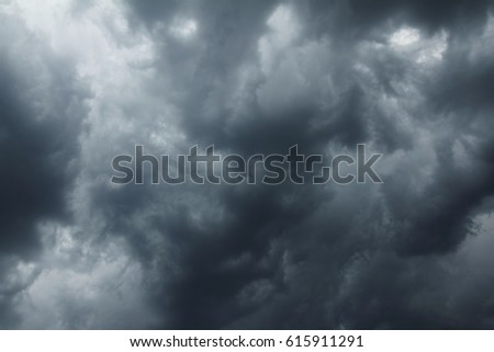 dramatic scene with storm clouds on moody sky #615911291