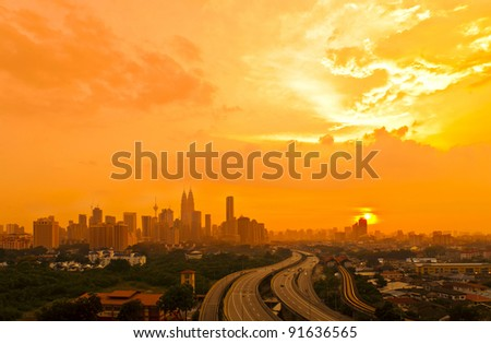 Dramatic scenery of the city center at sunset