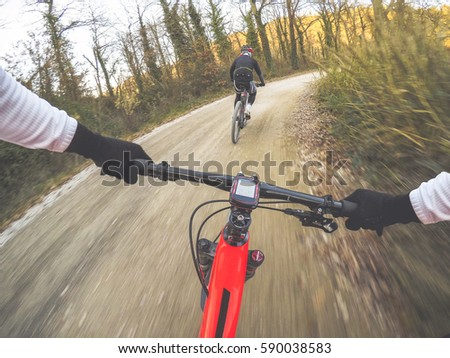 Shutterstock Dramatic shot of pair of young men mountain biking in a forest. POV Original point of view