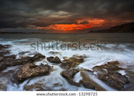 Dramatic Sky and windy clouds over Sardegna bay