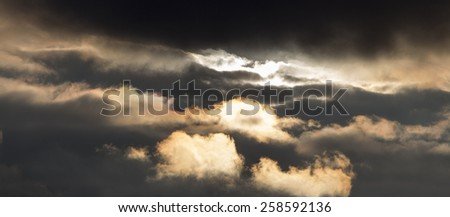 Dramatic sky at sunset.\The storm sky in rays of the setting sun. Cold dramatic decline.