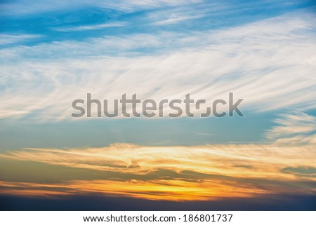 Dramatic sky at sunset with red, yellow, orange and blue colors #186801737