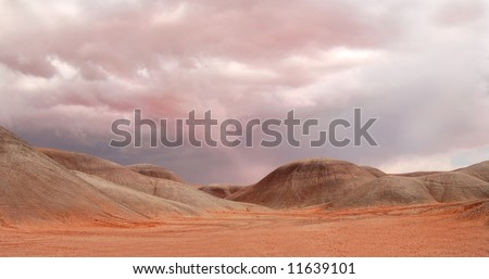 Dramatic sky looming over sand dunes near Monument Valley