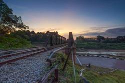 dramatic sky over a old bridge  at Segamat Railway Bridge