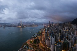 Dramatic sky over Hong Kong island Central distict and the Victoria harbor. Hong Kong is famous for being very crowded