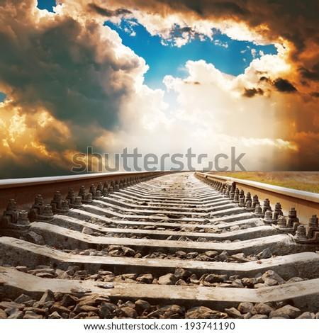 dramatic sky over railroad