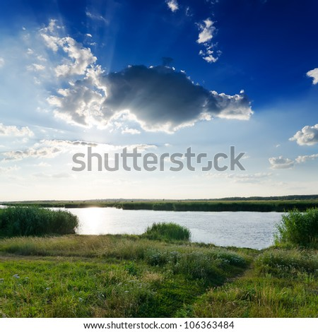 dramatic sky over river