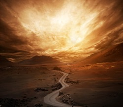 Dramatic sky over road in a valley.