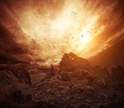 Dramatic sky over rocks.