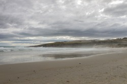 Dramatic sky over sandfly bay
