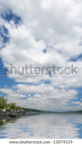 Dramatic sky reflecting in a lake. Suitable for a variety of travel, nature, environment designs