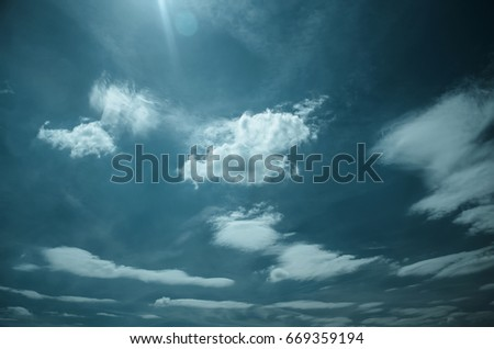 Dramatic sky. Saturated clouds before a thunderstorm, against the background of a blue sky. #669359194
