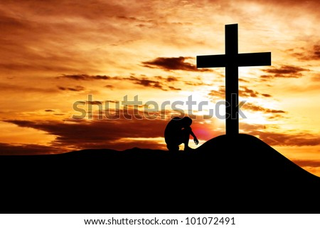 Dramatic sky scenery with a mountain cross and a desperation of man