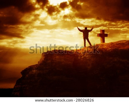Dramatic sky scenery with a mountain cross and a worshiping pilgrim. - stock photo