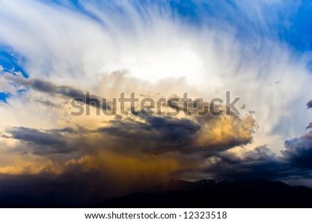 Dramatic sky under evening sunlignt - stock photo