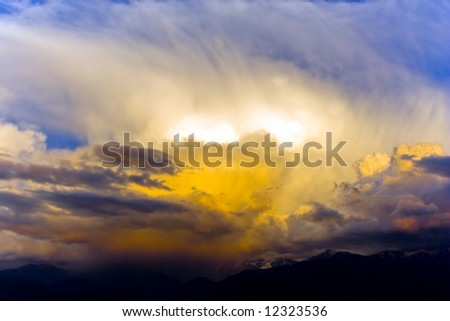 Dramatic sky under evening sunlignt