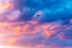 Dramatic sky with bright pink and dark blue stormy clouds. Nature background