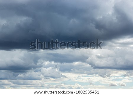 Dramatic sky with gray white blue clouds. Overcast and cloudy to rain ストックフォト ©