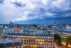 Dramatic sky with storm clouds over Paris, aerial panorama of Paris, France