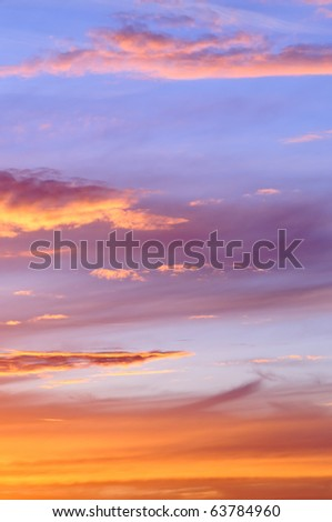 Dramatic sky with sunlit clouds at dusk