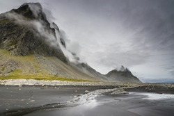 Dramatic Stokksnes  mountains in the clouds. East of Iceland.
